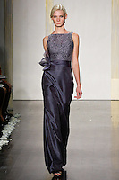 Model walks runway in a slate mikado organza A-line gown, lace bodice with bateau neckline, natural waist bridesmaid dress by Lazaro Perez, from the Noir by Lazaro Spring 2012 Bridal fashion show.
