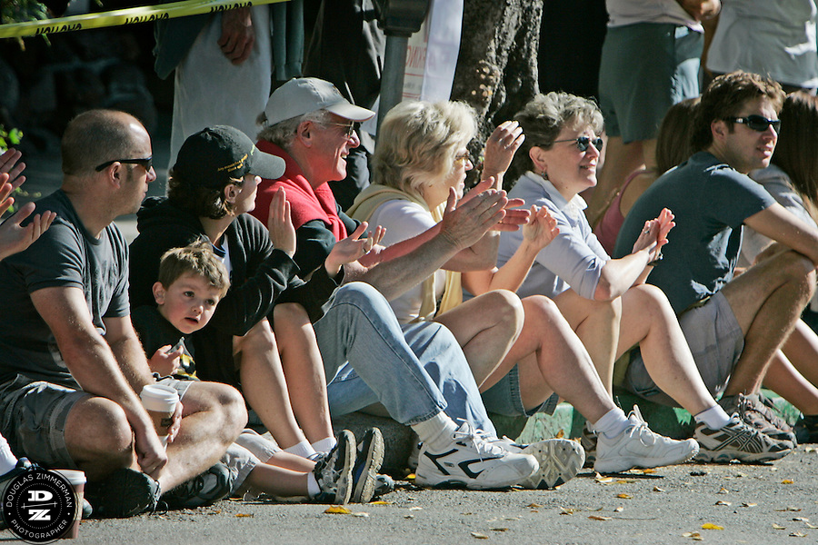 Spectators line up along Throckmorton street in downtown Mill Valley, Calif. cheer passing runners near the start of the 98th Dipsea Race in downtown Mill Valley, Calif on Sunday, June 8, 2008.  The Dipsea starts in Mill Valley, goes over Mt. Tamalapais, and ends in Stinson Beach.