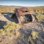 Rusted and abandoned car body, Warm Springs, Nev.