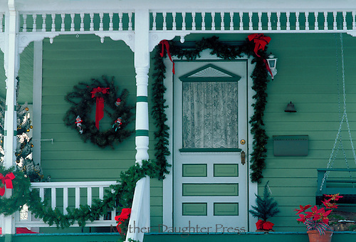 Victorian house decorated as a neighborhood Christmas house for the holiday
