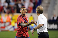 United States head coach Jurgen Klinsmann greets Danny Williams (7) as he is subbed out, The men's national team of the United States (USA) was defeated by Ecuador (ECU) 1-0 during an international friendly at Red Bull Arena in Harrison, NJ, on October 11, 2011.