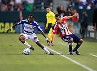 FC Dallas midfielder Marvin Chavez (18) makes a nice move on Chivas USA midfielder Jesus Padilla (10) during the first half of game between Chivas USA and FC Dallas at the Home Depot Center in Carson CA on June 26 2010. FC Dallas 2, Chivas USA 1.