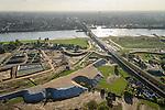 Nederland, Gelderland, Nijmegen, 24-10-2013;  Binnenstad Nijmegen spoorbrug en fietspad (De Snelbinder) over de rivier de Waal. Grondwerkzaamheden voor de dijkteruglegging Lent (Ruimte voor de Rivier). De dijken worden landinwaarts verplaats en er wordt een nevengeul gegraven. De huizen op de dijk blijven bestaan en komen te liggen op het Stadseiland Veur-Lent Nijmegen.<br /> Groundwork for the Dike relocation of Lent (project Ruimte voor de Rivier: Room for the River). In the back therailway bridge on the river Waal and the inner city of Nijmegen.<br /> luchtfoto (toeslag op standaard tarieven);<br /> aerial photo (additional fee required);<br /> copyright foto/photo Siebe Swart.