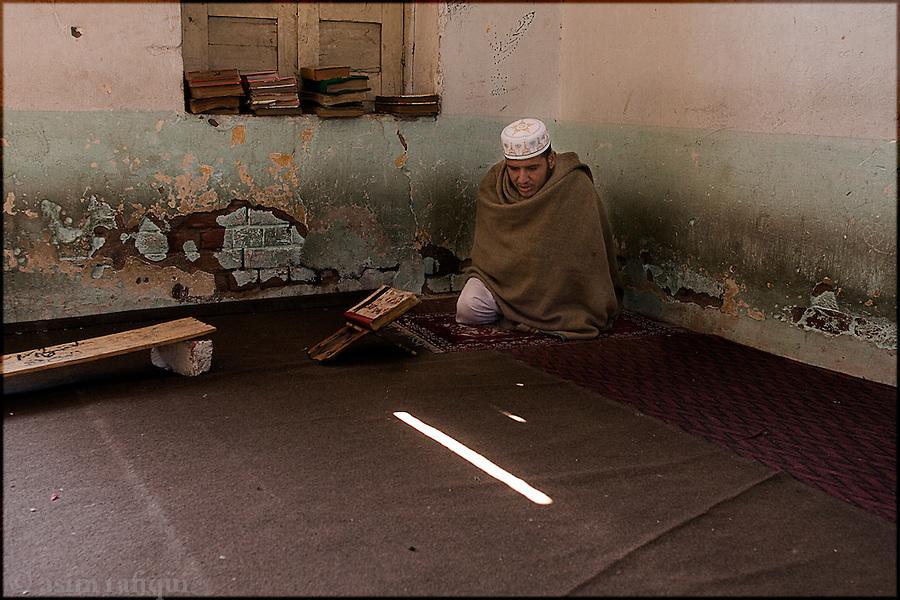a madrassa student at the daral-uloom sarhad madrassa in peshawar performs his koranic exercises