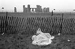 Free festival Stonehenge. Summer solstice 1976. Summer rain hippy sleeps in a make shift waterproof sleeping bag. ..