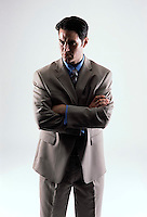 Caucasian looking man wearing a tan suit facing forward