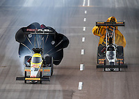 Feb 21, 2015; Chandler, AZ, USA; NHRA top fuel driver Spencer Massey (left) slows alongside Troy Buff during qualifying for the Carquest Nationals at Wild Horse Pass Motorsports Park. Mandatory Credit: Mark J. Rebilas-