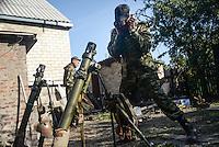 Pro-Russian rebels shoot mortars toward Ukrainian army positions in Donetsk