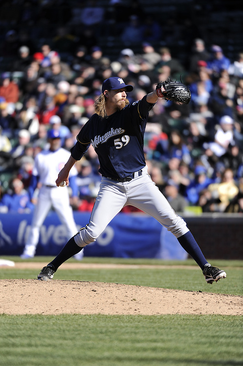 CHICAGO - APRIL  11:  John Axford #59 of the Milwaukee Brewers pitches against the Chicago Cubs on April 11, 2012 at Wrigley Field in Chicago, Illinois.  The Brewers defeated the Cubs 2-1.  (Photo by Ron Vesely)   Subject:  John Axford
