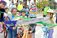 Santa Monica Mayor Richard Bloom cuts the ribbon at the new  Bicycle Campus  at Santa Monica Beach on  Earth Day,  Sunday, April 22, 2012.