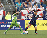 New England Revolution defender Flo Lechner (2) disrupts Seattle Sounders FC midfielder Mauro Rosales (10) dribble. In a Major League Soccer (MLS) match, the New England Revolution tied the Seattle Sounders FC, 2-2, at Gillette Stadium on June 30, 2012.