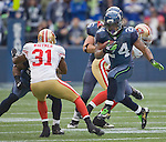 Seattle Seahawks fullback Michael Robinson blocks San Francisco 49ers strong safety Donte Whitner as running back Marshawn Lynch runs for an eight-yard gain at  CenturyLink Field in Seattle, Washington on December 24, 2011.  The 49ers came from behind to beat the Seahawks 19-17. ©2011 Jim Bryant Photo. All Rights Reserved.