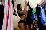 Sex worker Nina Nicole shops through lingerie brought by a travelling salesman to the Moonlite Bunny Ranch brothel in Mound House, NV on Thursday, July 27, 2006...The Moonlite Bunny Ranch brothel in Mound House, Nevada - just a few miles from the state capital in Carson City - first opened in 1955. The Ranch is a legal, licensed brothel owned by Dennis Hof. It's featured in the HBO series &quot;Cathouse.&quot;