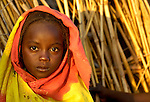 A girl living in a camp for internally displaced persons outside Kubum, in Sudan's violence-plagued Darfur region. Since 2003, as many as 400,000 people have been killed and 2,500,000 displaced by government-sanctioned violence against African farming communities in the region.