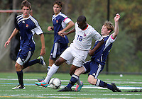 HYATTSVILLE, MD - OCTOBER 26, 2012:  Chris Odoi-Atsem (18) of DeMatha Catholic High School tackled by Nate Johnson (19) of St. Albans during a match at Heurich Field in Hyattsville, MD. on October 26. DeMatha won 2-0.