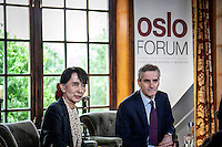 Burmese pro-democracy leader AUNG SAN SUU KYI attends the press conference held at the Oslo Forum in Losby Gods. The pop singer Bono and the norwegian Foreign Minister Jonas Gahr Støre meet Suu Kyi to attend the plenary during the forth and last day of her visit in Norway. Suu Kyi holds her first official diplomatic tour in Europe after 15 years in house arrest in Myanmar. She visits Switzerland, Norway, Ireland, Britain and France from June 13 to June 29 2012.
