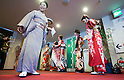 February 18, 2012, Tokyo, Japan - A woman (L) directs the kimono contestants to the stage during the 2012 Kimono Queen Contest. Approximately 500 women dressed in beautifully designed kimonos participate in this annual event for a chance to win special prizes and given the opportunity to be recognized as a kimono model in various media outlets. (Photo by Christopher Jue/AFLO)