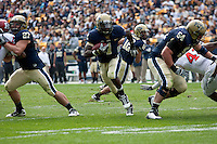Pitt running back Ray Graham uses blocks by Henry Hynoski (27) and Chris Jacobson (54) to score on a 13-yard touchdown run. The Pittsburgh Panthers defeated the Rutgers Scarlet Knights 41-21 on October 23, 2010 at Heinz Field, Pittsburgh, Pennsylvania....