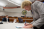 As one of the top three contenders in the Nov. 6 election for council from a pool of six candidates, Jeannie Bruins, above, signs paperwork during her swearing-in ceremony for the Los Altos city council.