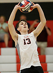 Cheshire, CT- 18 May 2017-051817CM10-  <br /> Cheshire's Matt Russolillo sets the ball during their SCC volleyball matchup against Xavier on Thursday.  Christopher Massa Republican-American
