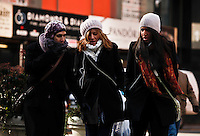 Tourists walks by a street as Low temperatures hit New York, United States. 23/01/2013 Photo by Kena Betancur/VIEWpress.