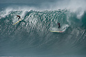 Unknown surfer during the Quiksilver Eddie Aikau at Waimea Bay on the Northshore of Oahu in Hawaii