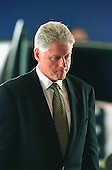 United States President Bill Clinton returns to his seat after delivering remarks at the Memorial Ceremony for the US Embassy personnel killed in Africa in a hanger at Andrews Air Force Base in Maryland on August 13, 1998.<br /> Credit: Ron Sachs / CNP