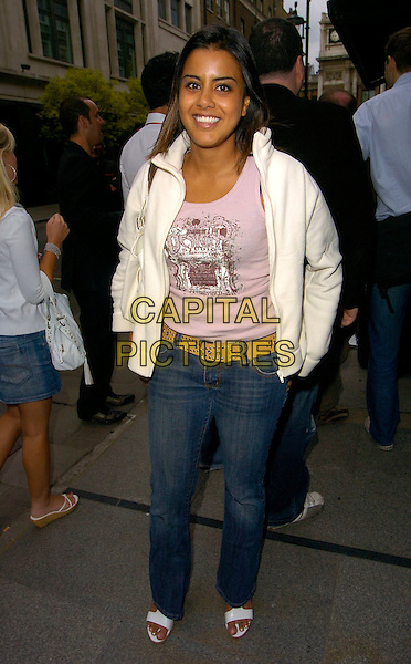 """POOJAH SHAH.""""The Beautiful Game"""" football party, Embassy Club, London, UK..June 19th, 2006.Ref: CAN.full length jeans denim white jacket belt.www.capitalpictures.com.sales@capitalpictures.com.©Capital Pictures"""