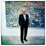 Eli Broad at his foundation in Venice, CA..Background images is Anselm Kiefer.Laßt 1000 Blumen Blühen, 1998.mixed media on canvas.74 7/8 x 220 5/8 inches.The Eli and Edythe L. Broad Collection, Los Angeles