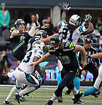 Seattle Seahawks  punter Jon Ryans kicks the ball to the Carolina Panthers  at CenturyLink Field in Seattle on October 18, 2015. The Panthers came from behind with 32 seconds remaining in the 4th Quarter to beat the Seahawks 27-23.  ©2015 Jim Bryant Photography. All Rights Reserved.