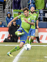 November, 2013: CenturyLink Field, Seattle, Washington: Seattle Sounders FC midfielder Brad Evans (3) takes a shot on goal  as the Portland Timbers take on the Seattle Sounders FC in the Major League Soccer Playoffs semifinals Round. Portland led 1-0 at the half.
