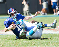 The Carolina Panthers played the New York Giants at Bank of America Stadium in Charlotte, NC.  The Panthers won 38-0 for their first victory of the season.  The Giants dropped to 0-3.  Carolina Panthers defensive tackle Kawann Short (99), New York Giants quarterback Eli Manning (10)