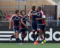 New England Revolution forward Jose Moreno (9) celebrates his goal with teammates. In a Major League Soccer (MLS) match, DC United defeated the New England Revolution, 2-1, at Gillette Stadium on April 14, 2012.