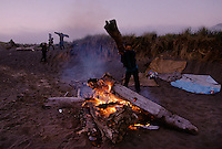 Carnival workers  build a beach bonfire in Gold Beach, Oregon. Carnies work 12-hour days, seven days a week at the Curry County Fair.