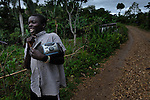 Radio at hand, a boy walks along a road n Despagne, a rural village in southern Haiti where the Lutheran World Federation has been working with residents to improve their quality of life.
