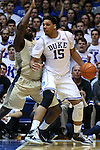 04 February 2015: Duke's Jahlil Okafor (15) and Georgia Tech's Damarco Cox (left). The Duke University Blue Devils hosted the Georgia Tech Yellow Jackets at Cameron Indoor Stadium in Durham, North Carolina in a 2014-16 NCAA Men's Basketball Division I game. Duke won the game 72-66.