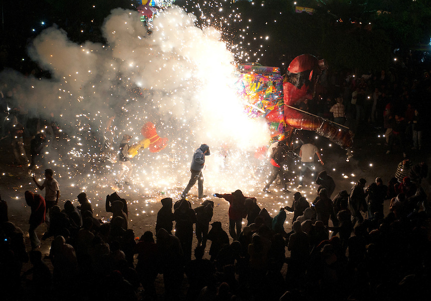 """The """"Toros"""" or bulls of Tultepec is a yearly tradition where the town, 90% of which works making artisanal fireworks, celebrates its patron sant San Juan de Dios, also the patron saint of firemen.  Tultepec, Estado de Mexico, Mexico."""