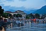 Lugano and the waterfront at night on Lake Lugano, Switzerland