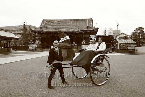 Mar 6, 2006; Tokyo, JPN; Asakusa.A ricksha driver and his passengers pause in front of the Asakusa-jinja next to the Senso-ji Buddhist temple (not pictured)...Photo credit:  Darrell Miho
