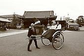 Mar 6, 2006; Tokyo, JPN; Asakusa.A ricksha driver and his passengers pause in front of the Asakusa-jinja next to the Senso-ji Buddhist temple (not pictured)...Photo credit:  Darrell Miho