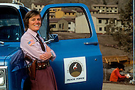 Wasco, Oregon, February 1984: Ma Deva Barkha, the police chief of the peace force of the city of Rajneeshpuram. Five of the six members of the Rajneeshpuram police are disciples of Bhagwan Rajneesh. Rajneeshpuram, was an intentional community in Wasco County, Oregon, briefly incorporated as a city in the 1980s, which was populated with followers of the spiritual teacher Osho, then known as Bhagwan Shree Rajneesh. The community was developed by turning a ranch from an empty rural property into a city complete with typical urban infrastructure, with population of about 7000 followers.