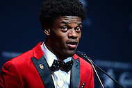 New York, NY - December 10, 2016: After winning the 2016 Heisman Trophy, Louisville quarterback Lamar Jackson speaks to members of the media during a news conference at the New York Marriott Marquis, December 10, 2016. At the time Jackson won the Heisman, he has a total of 4,928 offensive yards, 2nd of all-time for a Heisman winner. (Photo by Don Baxter/Media Images International)