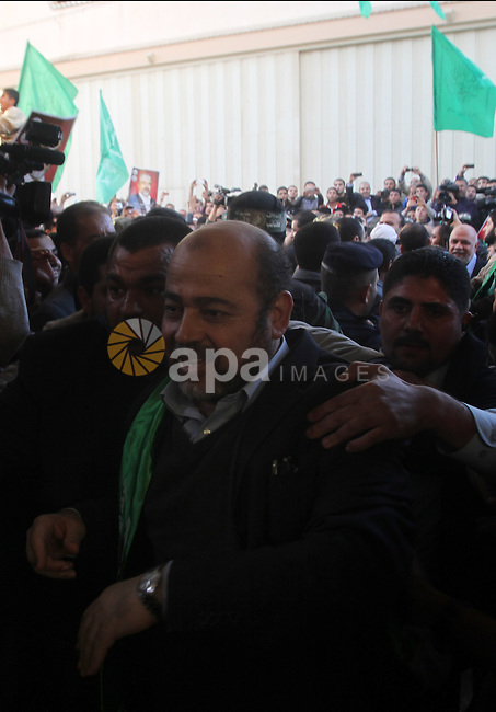 Hamas leader Mousa Abu Marzouq waves to the crowd upon his arrival in Gaza City December 7, 2012.  Hamas chief Khaled Meshaal is making his first-ever visit to the Gaza Strip amid tight security for festivities marking the ruling Islamist movement's 25th anniversary. Photo by Yasser Qudeh