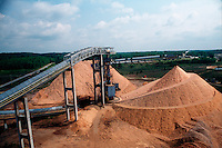 Piles of woodchips at a paper mill.