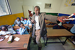A teacher leads a class discussion in a school in Cairo, Egypt, operated by by St. Andrew's Refugee Services, which is supported by Church World Service.