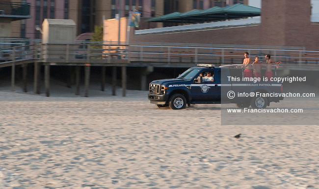 Lifeguards are seen on the back of a Beach Patrol pick up truck in Long Beach, NY, Monday August 1, 2011. Long Beach is a city in Nassau County, New York.