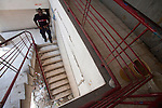 Firefighter Will Mondesir descends from the second floor of the Port-au-Prince, Haiti fire station, which was heavily damaged by the January 12 earthquake. The building has been deemed uninhabitable and marked for demolition, though no one can say when that may be. There are no plans yet for relocation. A few dozen under-equipped firefighters are tasked with providing fire service to a damaged city of over two million people.