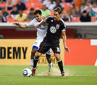 Josh Wolff (16) of D.C. United fights for the ball in the box with Steven Beitashour (33) of the San Jose Earthquakes celebrates his first goal during the game at RFK Stadium in Washington, DC.  D.C. United was defeated by the San Jose Earthquakes, 4-2.