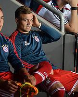 FUSSBALL  SUPERCUP  FINALE  2013  in Prag    FC Bayern Muenchen - FC Chelsea London          30.08.2013 Xherdan Shaqiri (FC Bayern Muenchen) sitzt zu Beginn des Spiels auf der Ersatzbank