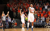 Dec. 17, 2010; Charlottesville, VA, USA; Virginia Cavaliers forward Akil Mitchell (25) and Virginia Cavaliers guard Joe Harris (12) reacts to a play during the first half of the game against the Oregon Ducks at the John Paul Jones Arena. Mandatory Credit: Andrew Shurtleff-